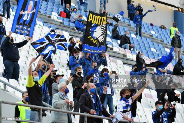 Fans interact from their seat in the stands during the TIMVISION Cup Final between Atalanta BC and Juventus on May 19, 2021 in Reggio nell'Emilia,...