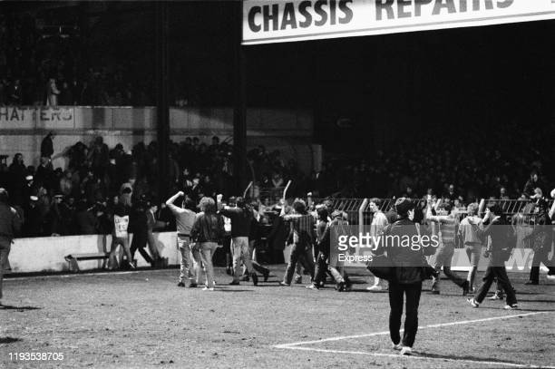 """Fans invade the field during the """"Luton Riot"""", which happened during Luton Town and Millwall FA Cup match at Kenilworth Road ground, Luton, UK, 13th..."""