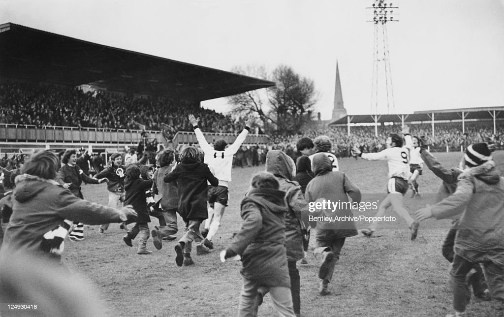 Fans invade the pitch at Edgar Street football stadium in Hereford, after Hereford United beat Newcastle United 2-1 in an FA Cup Third Round Replay, 5th February 1972.
