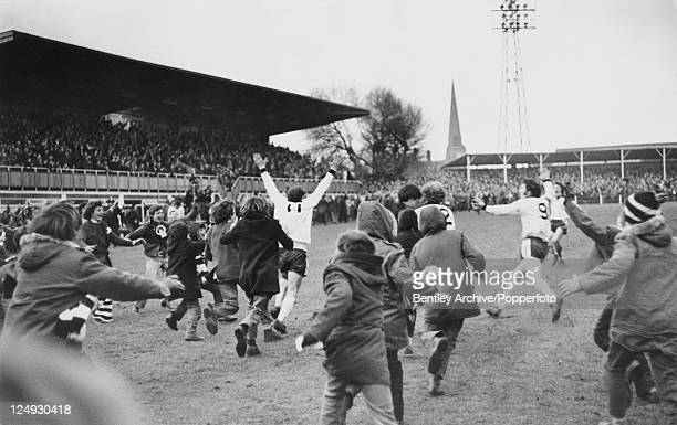 Fans invade the pitch at Edgar Street football stadium in Hereford after Hereford United beat Newcastle United 21 in an FA Cup Third Round Replay 5th...