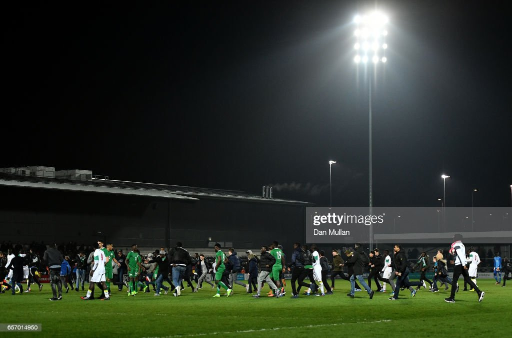 Fans invade the pitch at full time during the International Friendly match between Nigeria and Senegal at The Hive on March 23, 2017 in Barnet, England.