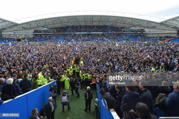 Fans invade the pitch at the end of the Sky Bet Championship match between Brighton Hove Albion and Wigan Athletic at Amex Stadium on April 17 2017...