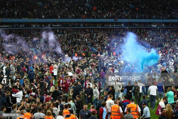 Fans invade the pitch at the full time whistle after the Sky Bet Championship Play Off Semi Final second leg match between Aston Villa and...
