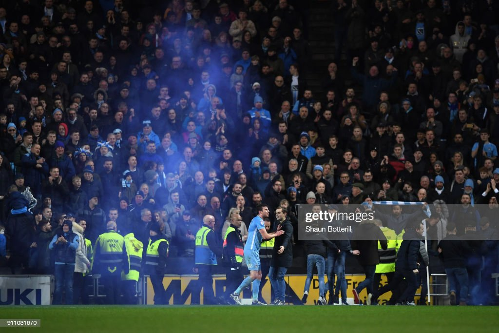 Fans invade the pitch during The Emirates FA Cup Fourth Round match between Milton Keynes Dons and Coventry City at Stadium mk on January 27, 2018 in Milton Keynes, England.