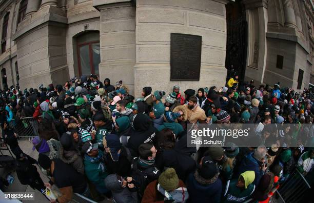 Fans jam the sidewalk in front of City Hall during the Philadelphia Eagles Super Bowl Victory Parade on February 8 2018 in Philadelphia Pennsylvania