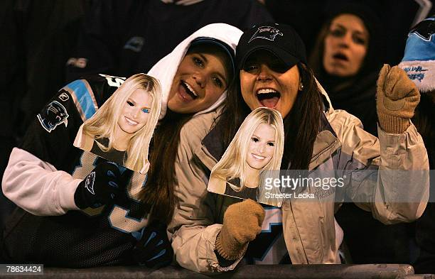 Fans joke about Tony Romo's girlfriend Jessica Simpson during the Dallas Cowboys versus Carolina Panthers game at Bank of America Stadium on December...