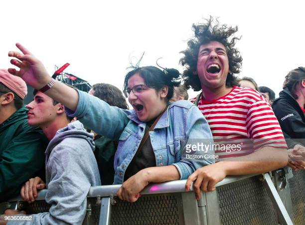 Fans Lauren McArthur and Kyle Benor right cheer as the band Alvvays performs during the Boston Calling Music Festival at the Harvard Athletic Complex...