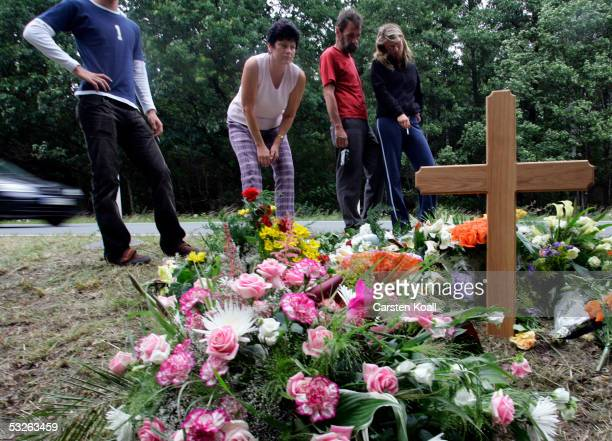 Fans lay flowers at a memorial for Australian cyclist Amy Gillett July 20 2005 in Zeulenroda eastern Germany Gillett was killed and five of her...
