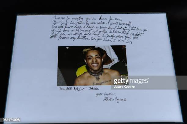 Fans leave art outside the XXXTentacion Funeral Fan Memorialat BBT Center on June 27 2018 in Sunrise Florida