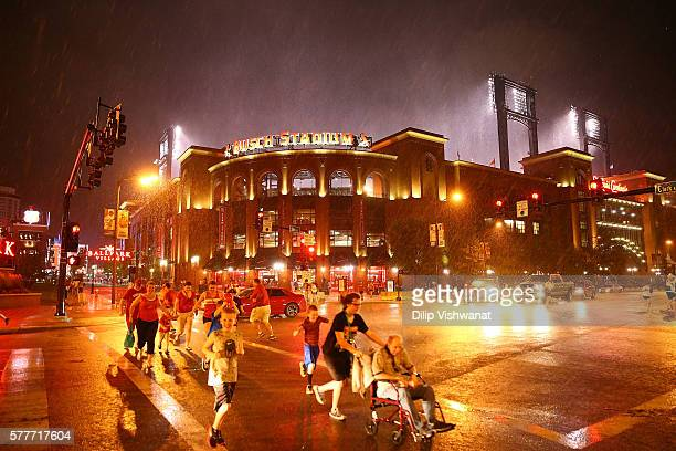 Fans leave Busch Stadium after the game between the St Louis Cardinals and the San Diego Padres was postponed due to weather on July 19 2016 in St...