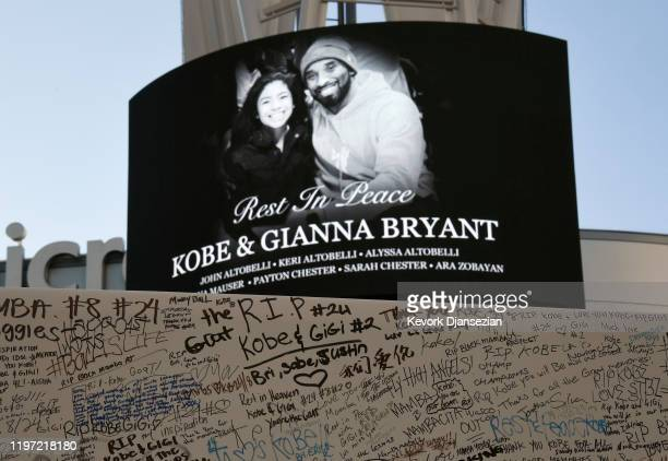 Fans leave condolence message on boards to pay their respects to Kobe Bryant and his daughter Gianna at a memorial set up outside of Staples Center...