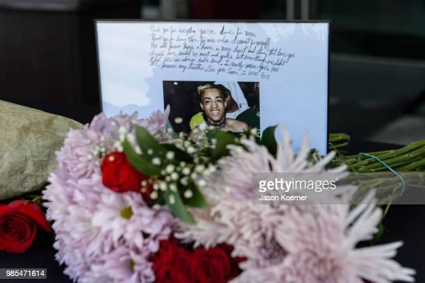 Fans leave flowers and art outside the XXXTentacion Funeral Fan Memorialat BBT Center on June 27 2018 in Sunrise Florida