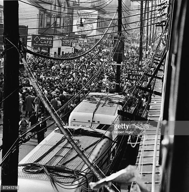 Fans leave Forbes Field after a World Series game between hometown team the Pittsburgh Pirates and the New York Yankees Pittsburgh Pennsylvania...
