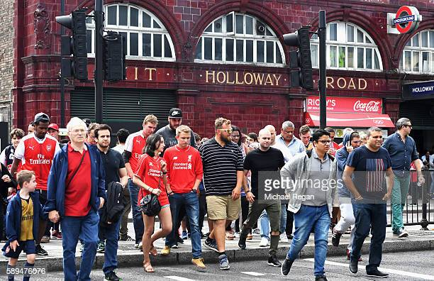 Fans leave Holloway Road tube station prior to the Premier League match between Arsenal and Liverpool at Emirates Stadium on August 14 2016 in London...