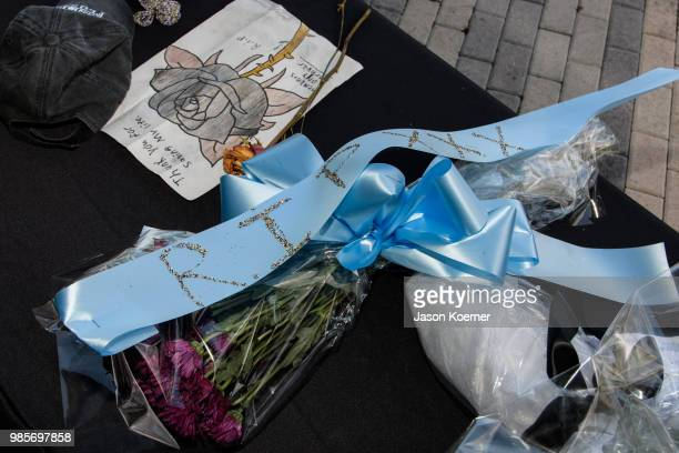 Fans leave items at a makeshift memorial outside the XXXTentacion Funeral Fan Memorial at BBT Center on June 27 2018 in Sunrise Florida