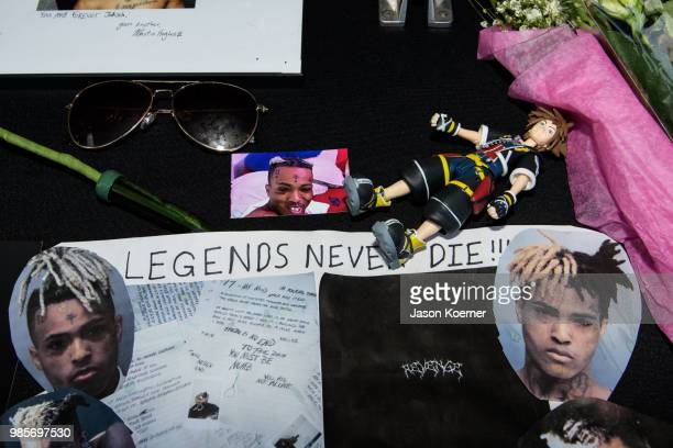 Fans leave items at a makeshift memorial outside XXXTentacion Funeral Fan Memorial at BBT Center on June 27 2018 in Sunrise Florida