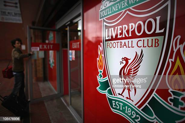Fans leave the club shop at Liverpool Football Club as plans on a buy out by American sports company NESV continues on October 15 2010 in Liverpool...
