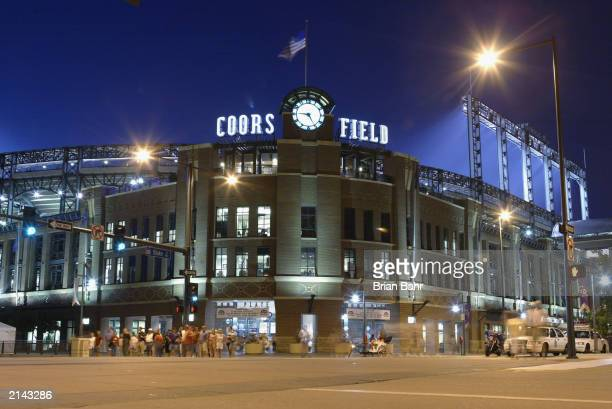 Fans leave the front entrance of Coors Field as the Arizona Diamondbacks play the Colorado Rockies into the evening in the National League game at...