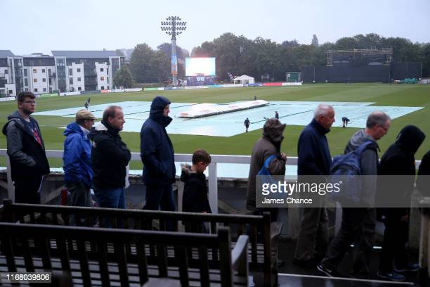 Fans leave the ground as the match is abandoned due to rain after the T20 Vitality Blast match between Kent Spitfires and Glamorgan at The Spitfire...