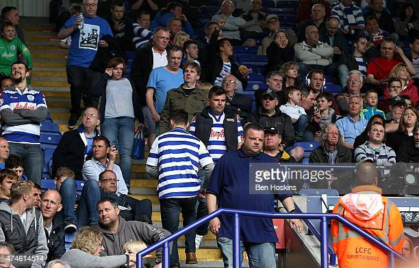 QPR fans leave the ground early during the Barclays Premier League match between Leicester City and Queens Park Rangers at The King Power Stadium on...