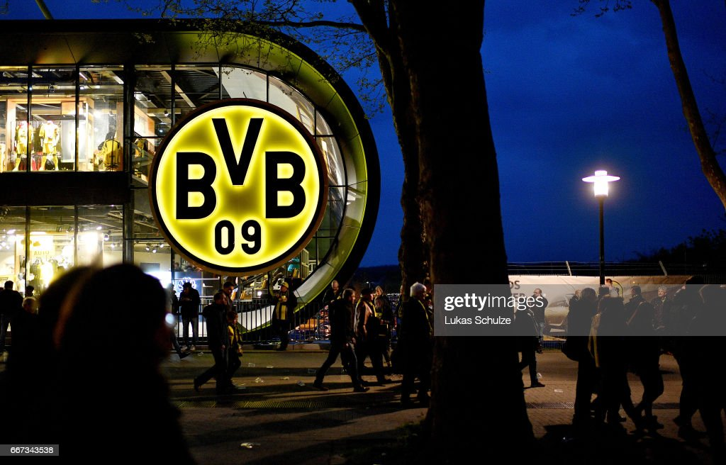 Fans leave the Signal Iduna Park area after the match between Borussia Dortmund and AS Monaco was cancelled after the team bus of the Borussia Dortmund football club was damaged in an explosion on April 11, 2017 in Dortmund, Germany. According to police an explosion detonated as the bus was leaving the hotel where the team was staying to bring them to their Champions League game against Monaco. So far one person, team member Marc Bartra, is reported injured.