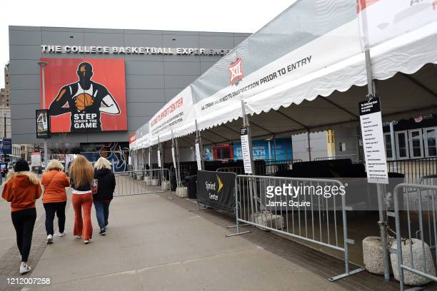 Fans leave the Sprint Center area as no fans will be allowed inside for the remainder of the Big 12 tournament games at the Sprint Center on March 12...