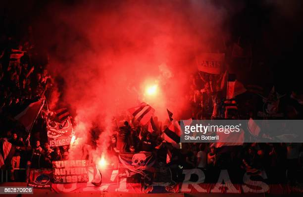 Fans let of a flare during the UEFA Champions League group B match between RSC Anderlecht and Paris SaintGermain at Constant Vanden Stock Stadium on...