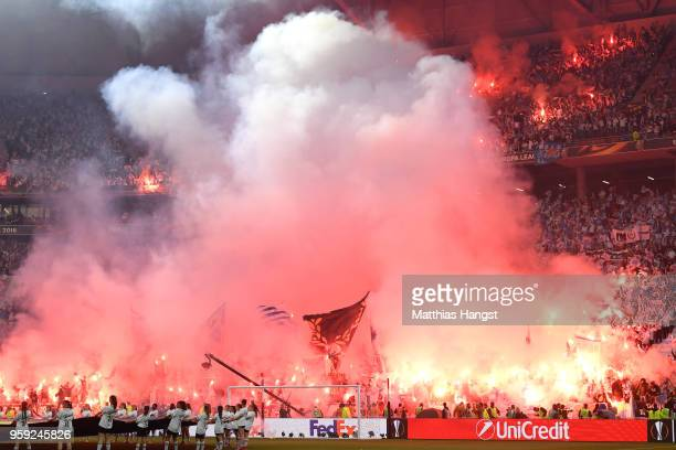 Fans let off flares ahead of the UEFA Europa League Final between Olympique de Marseille and Club Atletico de Madrid at Stade de Lyon on May 16 2018...