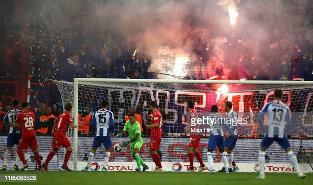 Fans let off flares during the Bundesliga match between 1. FC Union Berlin and Hertha BSC at Stadion An der Alten Foersterei on November 02, 2019 in...