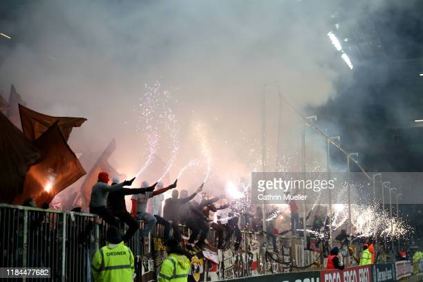 Fans let off flares during the DFB Cup second round match between FC St. Pauli and Eintracht Frankfurt at Millerntor Stadium on October 30, 2019 in...