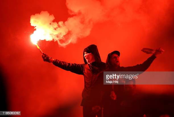 Fans let off flares inside the stadium during the Bundesliga match between 1 FC Union Berlin and Hertha BSC at Stadion An der Alten Foersterei on...