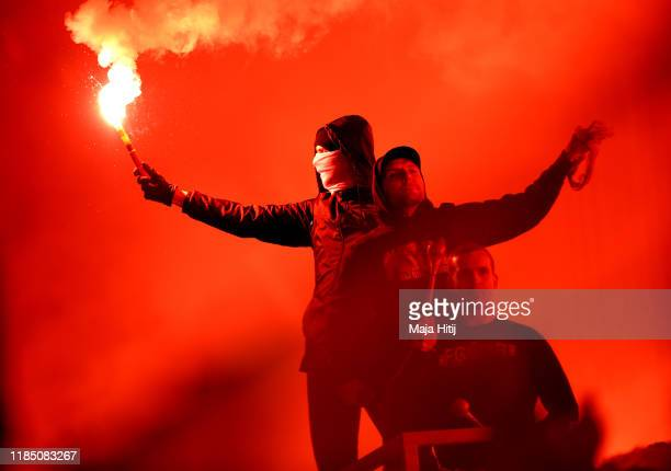 Fans let off flares inside the stadium during the Bundesliga match between 1. FC Union Berlin and Hertha BSC at Stadion An der Alten Foersterei on...