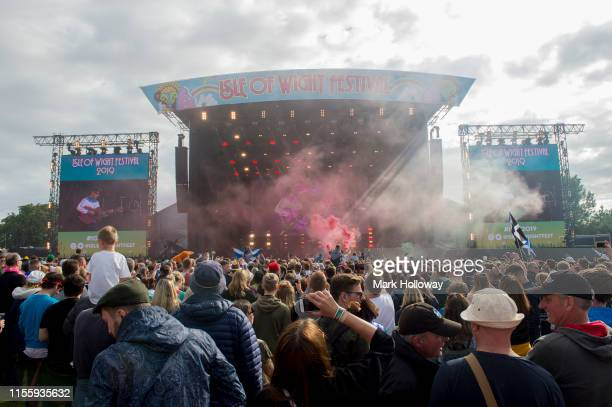 Fans letting off flares as Gerry Cinnamon performs on stage Isle of Wight Festival 2019 at Seaclose Park on June 14 2019 in Newport Isle of Wight