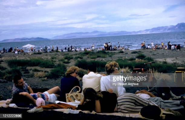 Fans lie on the ground during the Gold Cup Motorboat races on August 26, 1961 in Pyramid Lake, Nevada.
