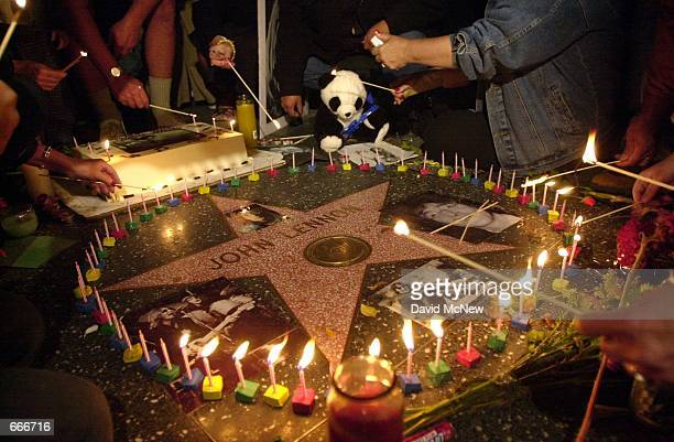 Fans light 60 candles around John Lennon's Walk of Fame star October 9 2000 outside the Capitol Records Tower Building in Hollywood CA in celebration...