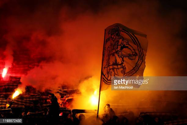 Fans light flares and show their support prior to the UEFA Europa League group G match between Rangers FC and BSC Young Boys at Ibrox Stadium on...