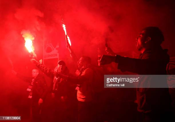 PSG fans light flares and smoke bombs after the UEFA Women's Champions League Quarter Final First Leg match between Chelsea Women and Paris...