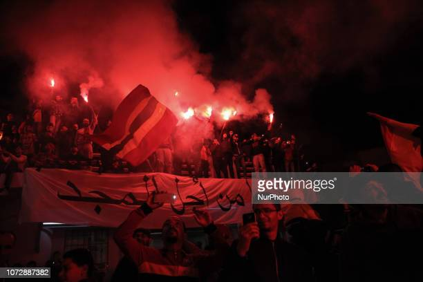 Fans light flares during the celebrations of the 100th anniversary of the Tunisian soccer club Espérance Sportive de Tunis in Ariana town Tunisia on...