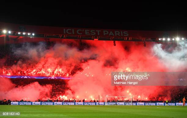 PSG fans light flares during the UEFA Champions League Round of 16 Second Leg match between Paris SaintGermain and Real Madrid at Parc des Princes on...
