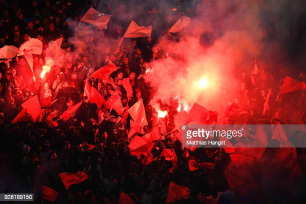 Fans light flares prior to the UEFA Champions League Round of 16 Second Leg match between Paris SaintGermain and Real Madrid at Parc des Princes on...