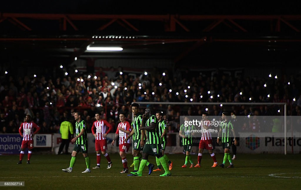 Fans light the stadium up with their mobile phones after a floodlight failure during the Sky Bet League Two play off, Second Leg match between Accrington Stanley and AFC Wimbledon at The Crown Ground on May 18, 2016 in Accrington, England.