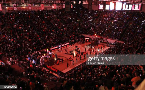 Fans light up Cassell prior to the game between the Virginia Tech Hokies and the University of Virginia Cavaliers at Cassell Coliseum on February 18...