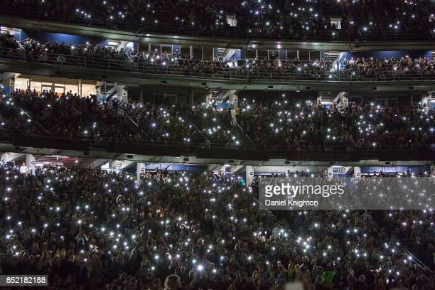 Fans light up the stadium using their cell phones on the final night of U2 The Joshua Tree Tour 2017 at SDCCU Stadium on September 22 2017 in San...