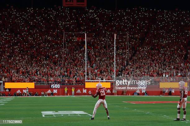 Fans light up the stadium with cell phones during the game between the Nebraska Cornhuskers and the Northern Illinois Huskies at Memorial Stadium on...