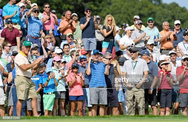 Fans line the fairway watching golf action during the third round of THE NORTHERN TRUST at Glen Oaks Club on August 26 in Old Westbury New York
