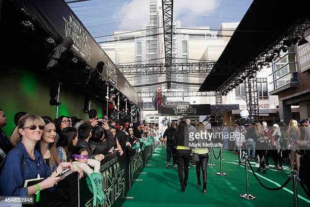 """Fans line the green carpet at the Sydney Special Event Screening of """"Teenage Mutant Ninja Turtles"""" at The Entertainment Quarter on September 7, 2014..."""