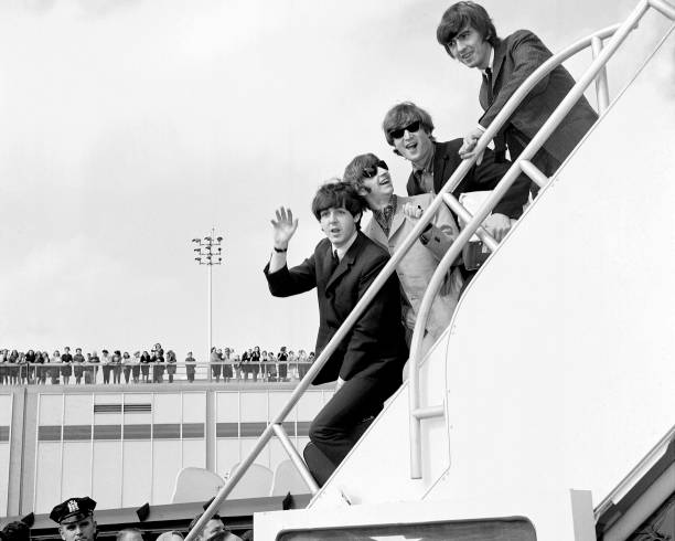 Fans line the rooftop at Kennedy International Airport for a