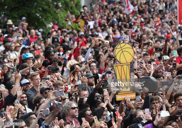TORONTO ON JUNE 17 Fans line the route as the Toronto Raptors hold their victory parade after beating the Golden State Warriors in the NBA Finals in...