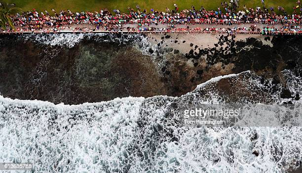 Fans line the shore to watch the swim portion of the 2016 IRONMAN World Championship triathlon on October 8 2016 in Kailua Kona Hawaii
