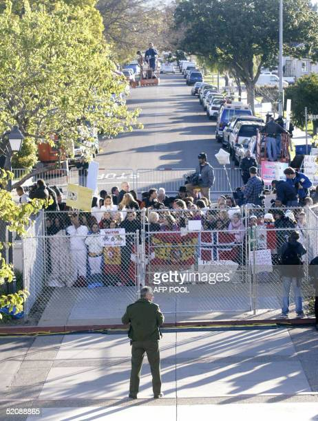 Fans line the streets outside the Santa Barbara County Courthouse as jury selection gets underway in Michael Jackson's child molestation trial in...